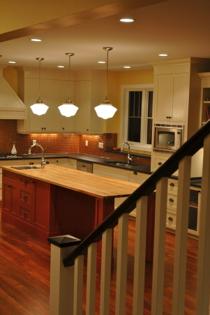 Burst of color..., This is a kitchen that was in a custom home we completed. The clients were a lot of fun and wanted that to show through with the finishing, including the orange island! Hope you enjoy the images. :) Check out my other spaces and come see my blog... http://verandainteriors.blogspot.com/, View coming down the stairwell from the upper level.   , Kitchens Design