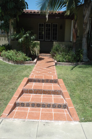 Tropical, I looked at this dead yard for 4 years until the owners allowed me to give it a make over., I paved the sidewalk with mexican tile and color pickits.   , Landscaping