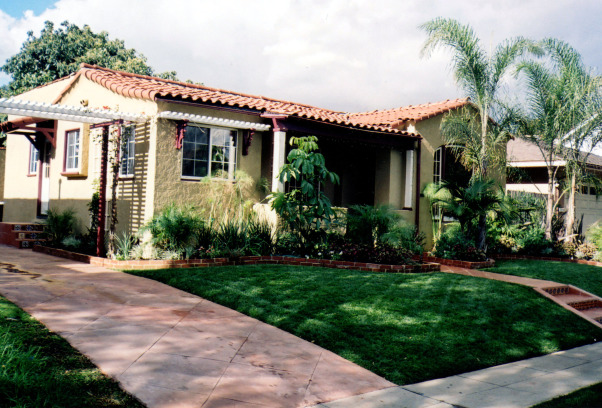 Tropical, I looked at this dead yard for 4 years until the owners allowed me to give it a make over., I widened and resurfaced the driveway in a terracotta color.   , Landscaping