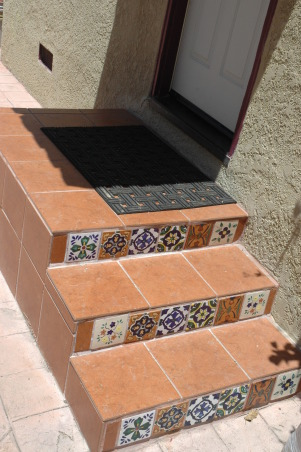 Tropical, I looked at this dead yard for 4 years until the owners allowed me to give it a make over., I tiled the kitchen steps to match the front walk since it could be seen from the street  , Landscaping