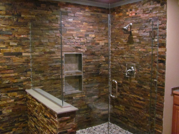 shower with a frameless shower enclosure we used a 12x12 slate tile