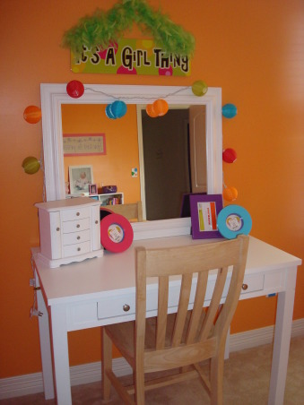 "Bright & Colorful 4 year old's room, I wanted my 4 1/2 yr old daughter's room to fit her personality and I believe I accomplished that with this bright, cheery room! :), Cute little desk doubles as a vanity. I still need to paint her chair white to match. Both found on Craigslist! Mini lantern string lights from JC Penney. ""It's a girl thing"" sign from Toys R Us. , Girls' Rooms Design"