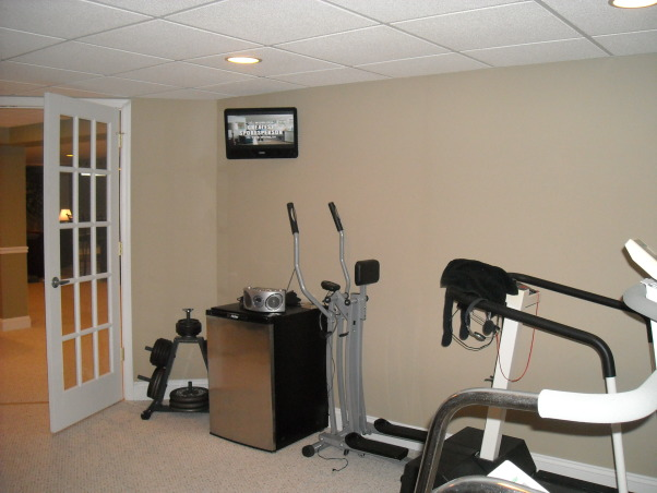 My Woman Cave, 2200 sq. ft. of fun! A true getaway complete with closet, bar, card room, bathroom, living area, game room, exercise room and storage area for years of enjoyment., Exercise Room , Basements Design