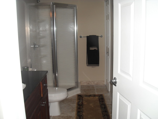 My Woman Cave, 2200 sq. ft. of fun! A true getaway complete with closet, bar, card room, bathroom, living area, game room, exercise room and storage area for years of enjoyment., Full bath, Basements Design