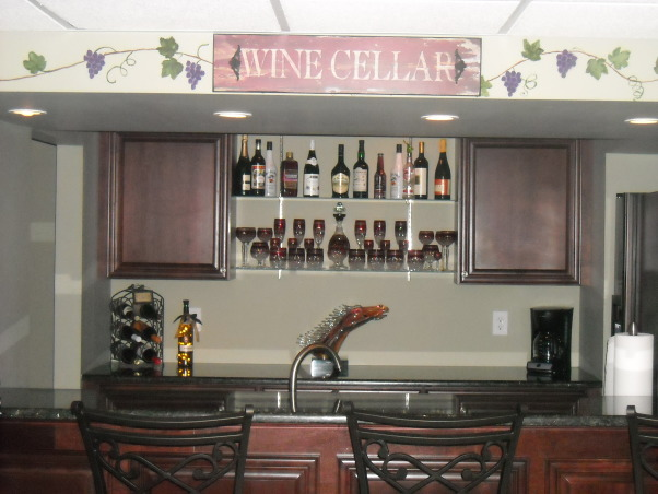 My Woman Cave, 2200 sq. ft. of fun! A true getaway complete with closet, bar, card room, bathroom, living area, game room, exercise room and storage area for years of enjoyment., Close-up shot of the wet bar. , Basements Design