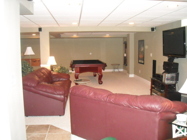 My Woman Cave, 2200 sq. ft. of fun! A true getaway complete with closet, bar, card room, bathroom, living area, game room, exercise room and storage area for years of enjoyment., Living area , Basements Design