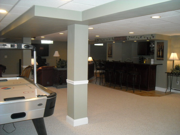 My Woman Cave, 2200 sq. ft. of fun! A true getaway complete with closet, bar, card room, bathroom, living area, game room, exercise room and storage area for years of enjoyment., View from exercise room looking across basement. , Basements Design