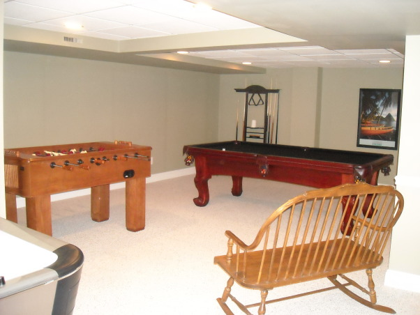 My Woman Cave, 2200 sq. ft. of fun! A true getaway complete with closet, bar, card room, bathroom, living area, game room, exercise room and storage area for years of enjoyment., Game room area , Basements Design