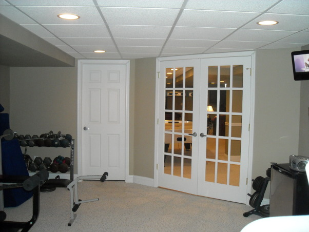 My Woman Cave, 2200 sq. ft. of fun! A true getaway complete with closet, bar, card room, bathroom, living area, game room, exercise room and storage area for years of enjoyment., View from exercise room out to main living area., Basements Design