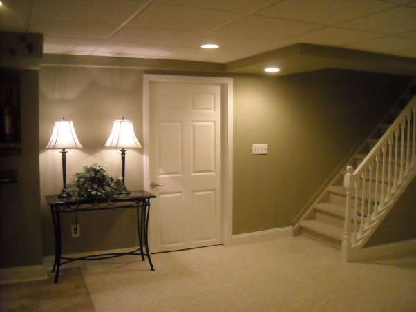 My Woman Cave, 2200 sq. ft. of fun! A true getaway complete with closet, bar, card room, bathroom, living area, game room, exercise room and storage area for years of enjoyment., Landing at the foot of the stairs, the door leads to a large closet used for off season clothes. , Basements Design