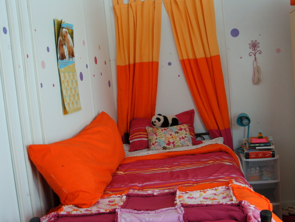 Ahhh CHU, My home away from home in Iraq - Containerized Housing Unit. Full of feminine color in a tan and olive drab world., My roommate's awesome bed, homemade fleece blanket and fun curtains. , Dorm Rooms Design