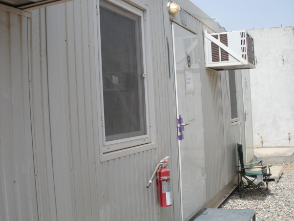 Ahhh CHU, My home away from home in Iraq - Containerized Housing Unit. Full of feminine color in a tan and olive drab world., This is the outside of our CHU. We're the room in the middle. , Dorm Rooms Design