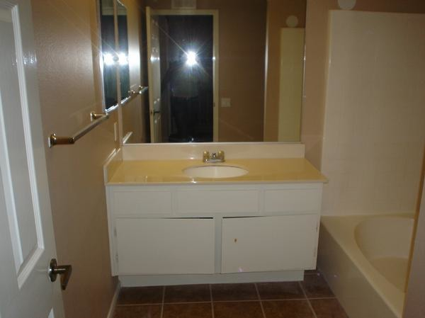 Low budget bathroom remodel, Moved into a foreclosure with a small budget for renovations. We did our best with what we could and even though my space is a little plain I still like it :), Before, Bathrooms Design