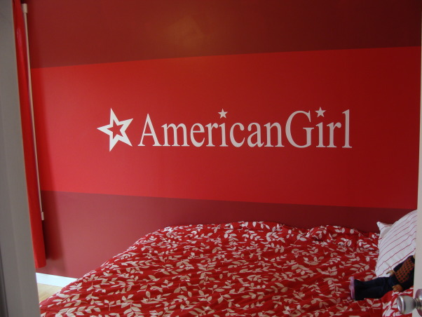 American Girl Room, My daughter wanted an American Girl Room but can't buy that at a store.  We color matched the paint at Lowes(took in a doll box) Ordered the custom sticker online. Bedding is from Target, posters were bought on Ebay because they are vintage and they don't make them anymore.Had to buy them at different times.  Daisy picture was painted by a local artist. Dressers were painted white. The flooring is bamboo. My husband was awesome through all of this.  I couldn't have done it without him!!! , Custom Sticker bought online.  I emailed the logo from the box. , Girls' Rooms Design