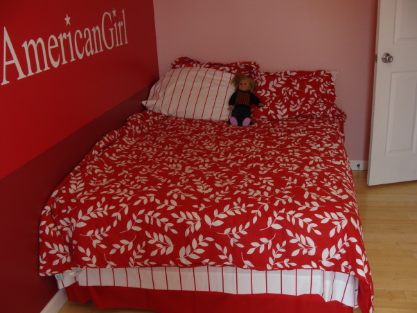 American Girl Room, My daughter wanted an American Girl Room but can't buy that at a store.  We color matched the paint at Lowes(took in a doll box) Ordered the custom sticker online. Bedding is from Target, posters were bought on Ebay because they are vintage and they don't make them anymore.Had to buy them at different times.  Daisy picture was painted by a local artist. Dressers were painted white. The flooring is bamboo. My husband was awesome through all of this.  I couldn't have done it without him!!! , Bedding from Target, a full size bed fits perfect in this room. , Girls' Rooms Design