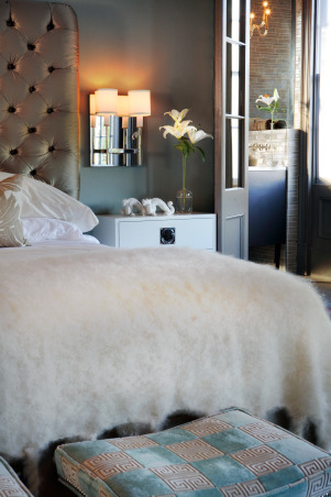 Designer Showhouse - Master Bedroom, Mohair blanket, custom headboard and floating lacquered sidetables, mirrored sconces, reuphostered stools (tabourets) in a Greek Key fabric, mirrored double doors leading into bath, custom cowhide rug   , Bedrooms Design