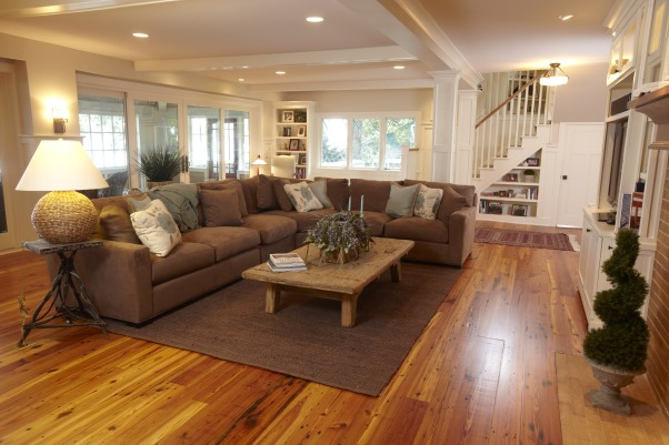 Living Room Renovation, This project was a complete home renovation.  This living room was outdated with green carpet and small sliding doors that led to a sun porch which made the space feel very dark.  We added a wall of doors to the sun porch which brought in natural light.  We also added a hallway with built-ins and a powder room that leads to the kitchen.  This really enhanced the traffic pattern throughout the first floor.  The stair case was also completely rebuilt., Reclaimed floors, built-ins, wainscotting, and walls of glass transformed this space from dark and drab to light and cozy., Living Spaces