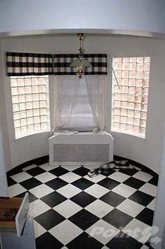 Retro Black and White Checkerboard Kitchen , We recently bought a 1941 Colonial home that has a retro style checkerboard flooring in the kitchen.  The kitchen needs some updating.  I am thinking of putting in stainless steel appliances and a farmhouse stainless steel sink etc.  I am looking for ideas.  I was thinking of painting it a lime green.  I was also thinking about getting rid of the checkerboard flooring (but it is growing on me).  I was thinking of wood floors that match the hardwood floors in the remainder of the house.   Please all ideas are welcome., Round breakfast nook.  I was thinking of having a built in circular window seat with either a black or white round table.      , Kitchens Design