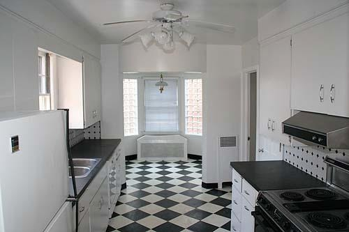 Retro Black and White Checkerboard Kitchen , We recently bought a 1941 Colonial home that has a retro style checkerboard flooring in the kitchen.  The kitchen needs some updating.  I am thinking of putting in stainless steel appliances and a farmhouse stainless steel sink etc.  I am looking for ideas.  I was thinking of painting it a lime green.  I was also thinking about getting rid of the checkerboard flooring (but it is growing on me).  I was thinking of wood floors that match the hardwood floors in the remainder of the house.   Please all ideas are welcome., Kitchens Design
