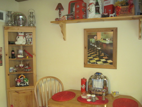 Coca Cola kitchen, Kitchen/dining room with coca cola memorabilia collected from family and friends. Trying to stay with informal diner style., Dining room with coca cola collectibles in corner cabinet and on shelf, Kitchens Design