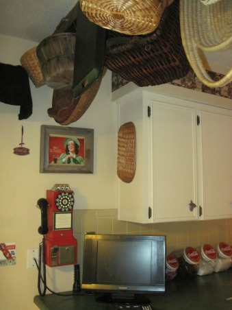 Coca Cola kitchen, Kitchen/dining room with coca cola memorabilia collected from family and friends. Trying to stay with informal diner style., Baskets hanging from wood ceiling beams, vintage telephone, coca-cola cannisters , Kitchens Design