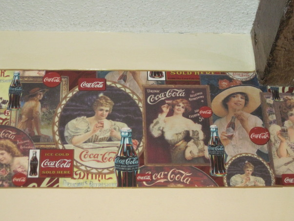 Coca Cola kitchen, Kitchen/dining room with coca cola memorabilia collected from family and friends. Trying to stay with informal diner style., Vintage paper border on soffit in kitchen only , Kitchens Design