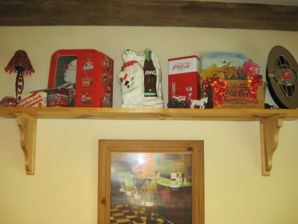 Coca Cola kitchen, Kitchen/dining room with coca cola memorabilia collected from family and friends. Trying to stay with informal diner style., Collectibles on shelf , Kitchens Design