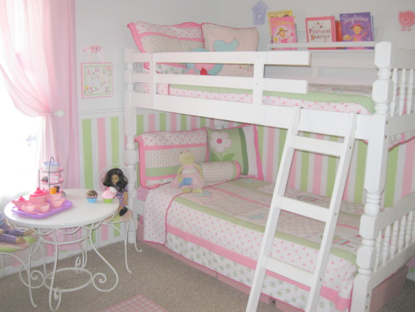 4 and 6 year old shared bedroom, My husband and I recently decided to move our six year old into a bedroom with our four year old.  The room is small so we went with the dreaded bunk beds. I was very hesitant at first, but it seems to be working out quite well so far. , The bedding was purchased from T J Maxx.  The sets are the same, but the bottom set was sold under the Jillian's Closet label and the set on the top bunk was sold under the Maggie Miller label. The line name is Evalyn Bird. My husband built the little bookshelf so my six year old could have easy access to her books at bedtime. The table and chair set was purchased from target online several years ago.  , Girls' Rooms Design