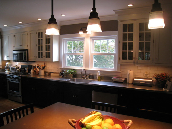 Colonial Kitchen Renovation Update, We FINALLY finished all the mouldings in our not-quite-new-anymore kitchen! It took a while, but my husband built them all himself. Still haven't decided on window treatments..., The kitchen in our 100 year old farmhouse was taken down to the studs. I chose black base cabinets and creamy white upper cabinets inspired by a Candace Olsen design.      , Kitchens Design