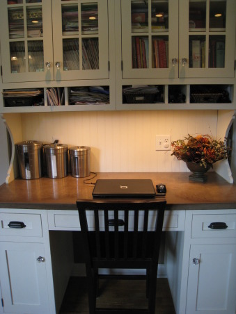 Colonial Kitchen Renovation Update, We FINALLY finished all the mouldings in our not-quite-new-anymore kitchen! It took a while, but my husband built them all himself. Still haven't decided on window treatments..., Concrete desk area. Cubbies for everyday items and cabinets for cookbooks were a neccessity.     , Kitchens Design