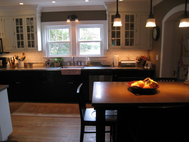 Colonial Kitchen Renovation Update, We FINALLY finished all the mouldings in our not-quite-new-anymore kitchen! It took a while, but my husband built them all himself. Still haven't decided on window treatments..., New concrete breakfast bar and desk area add warmth to the stainless steel countertop (original to the house, and the only thing we kept) and appliances.      , Kitchens Design