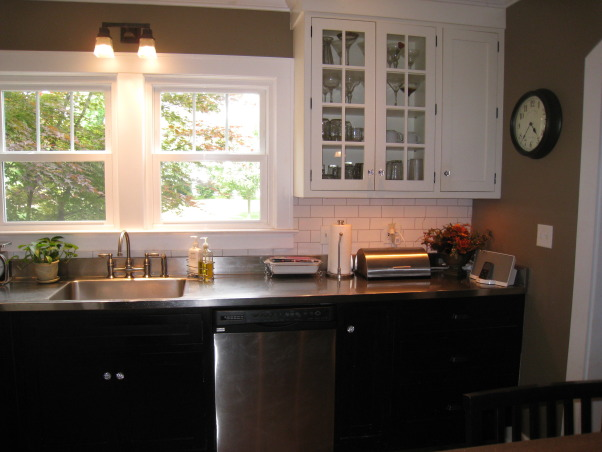 Colonial Kitchen Renovation Update, We FINALLY finished all the mouldings in our not-quite-new-anymore kitchen! It took a while, but my husband built them all himself. Still haven't decided on window treatments..., Ceiling-height inset cabinets, antique bronze and crystal hardware, exposed hinges and white subway tile all help preserve the period look.     , Kitchens Design