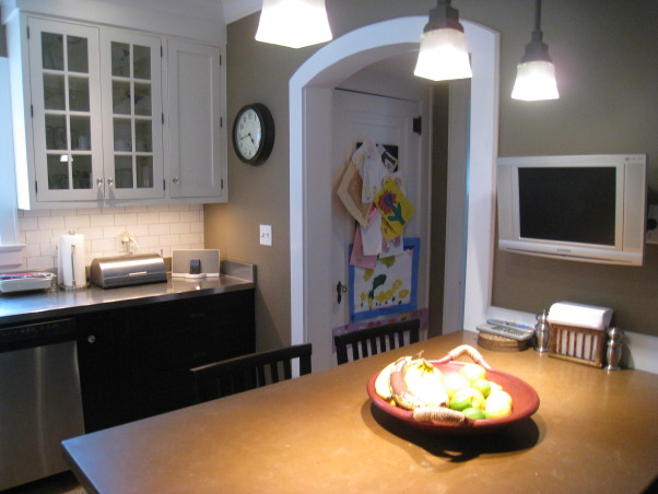 """Colonial Kitchen Renovation Update, We FINALLY finished all the mouldings in our not-quite-new-anymore kitchen! It took a while, but my husband built them all himself. Still haven't decided on window treatments..., Kids' artwork is """"hidden"""" in the fridge alcove.     , Kitchens Design"""