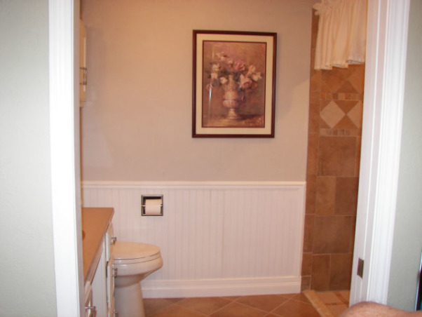 Wheelchair Friendly Bathroom, Our tiny bathroom was so small that my husband could not get his wheelchair to even go through the doorway so we added 2 feet from the bedroom and rearranged the room. We chaged the small hinged door to a pocket door.  We tiled the floor on the diagonal and put down slip resistant tile in the shower stall. We also installed appropriate handrails and a handicap toilet. Now he can wheel circles in the center of the floor and proceed right into the shower.  Although the area is still small, there is room for him to manouver and enjoy his shower!, This picture is taken at the door's edge.  The sink, toilet and medicine cabinet is on the left and the shower on the irght leaving the center of the room for my husband to turn around in his wheelchair., Bathrooms Design