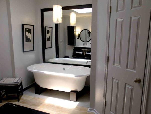 Japanese inspired remodel, Our 80's outdated bathroom received a total redo of everything except the floor.  About 95% of the items were bought on line.  The redo took 20 days. , Oriental soaking tub on wood blocks. The mirror was simply framed in black. I chose black, white and gray as the color scheme. The tub (signaturehardware.com), light and woodblock print were purchased online.       , Bathrooms Design