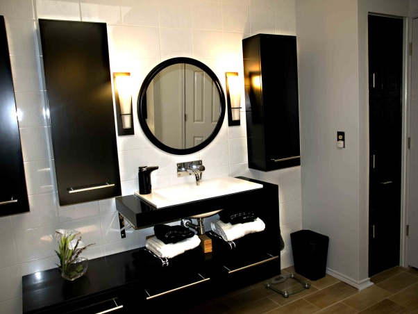 Japanese inspired remodel, Our 80's outdated bathroom received a total redo of everything except the floor.  About 95% of the items were bought on line.  The redo took 20 days. , The black floating cabinets were also purchased online and came with the sink, faucet and mirror. I replaced the mirror and faucet. The wall had to be reinforced to hold the cabinets. The floating cabinets create great space.        , Bathrooms Design