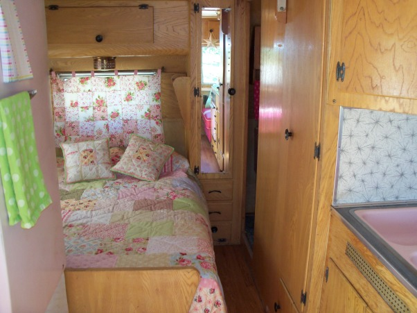 Vintage Travel Trailer, This is my tin can cottage.  I bought a vintage 1959 Kenskill Travel Trailer and began the process of decorating the inside.  I bought it because it had pink appliances - 2 DIE 4!!!  So cute!, Full size bed with handmade quilt by my dear mom. , Other Spaces Design