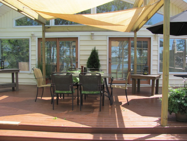 Cottage Outdoor Living, This is our front deck at the cottage which is facing the lake and a spacious spot to dine and relax., Patios & Decks Design