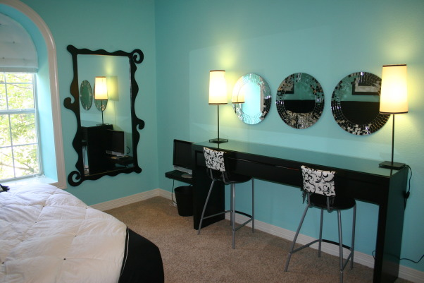 Tiffany Blue Teen bedroom, L-shape faux fur headboard, king size bedding, custom pillows.  Beauty bar with custom shaped mirrors and upholstered barstools., Girls' Rooms Design