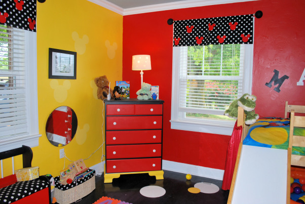 MICKEY MOUSE, Our 2 1/2 year old is a Mickey Mouse fanatic.  We Painted bold colors and made a light yellow stencil on the bright yellow wall.  We repainted all of his furniture using Mickey Mouse as our theme.  The floor is painted black with yellow, red , and white circles.  We tried to keep everything at his level and really used alot of round objects and accents., Boys' Rooms Design