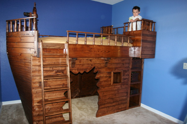 "Pirate Ship Bed, This is the pirate ship bed that I;ve just finished for my 5 year old stepson.  There's a ""blast hole"" entrance for the play area underneath the bed, and a secret passageway under one of the rear storage benches on the top that goes to the play area.  , Boys' Rooms Design"