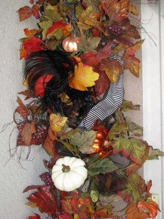 "Halloween by Michelle, Halloween, for me, is about magic and whimsy.  I like decorating with a ""Yester-year"" style, using little witches and black cats,  paper mache pumpkin heads and crate paper ruffles.  My haunt, inside and out, is ""little kid friendly"" and I won't put anything up that will scare them.     , The raven dropped a black feather at your door..        , Holidays Design"