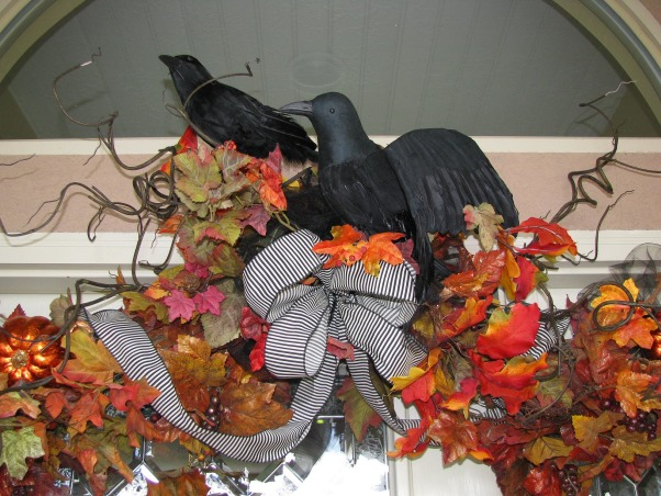 "Halloween by Michelle, Halloween, for me, is about magic and whimsy.  I like decorating with a ""Yester-year"" style, using little witches and black cats,  paper mache pumpkin heads and crate paper ruffles.  My haunt, inside and out, is ""little kid friendly"" and I won't put anything up that will scare them.     , ""Quoath the raven..""  I found the ribbon at Michaels.         , Holidays Design"