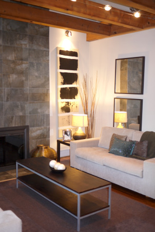 A modern and chic living room, Welcome to our living room. Come on in, have a sit and let me tell you a little bit about this room. Our space was designed to work well with our style as well as our lifestyle. We like it simple, no clutter. We like it modern looking, fresh and chic. We chose muted colors that work well together. The wooden beams and fireplace are the focal point of the room. It is the first thing people talk about when they come in the house. My brother-in-law did the two beautiful paintings that flank the fireplace. He actually painted them after the room was done. And we think he did a beautiful job. When we hung the paintings on the wall, it was like putting the perfect, well matched icing, on the cake. We are very pleased with how everything turned out. What about you?  What do you think? Feel free to e-mail me at patchi@trendypeas.com for all the sources., View from the stairs , Living Rooms Design