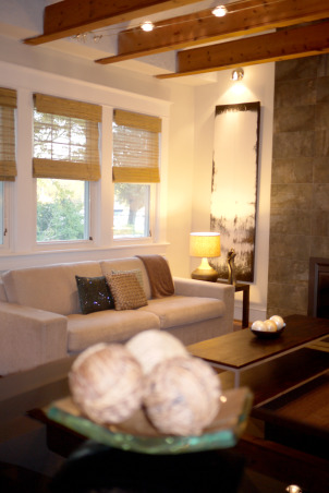 A modern and chic living room, Welcome to our living room. Come on in, have a sit and let me tell you a little bit about this room. Our space was designed to work well with our style as well as our lifestyle. We like it simple, no clutter. We like it modern looking, fresh and chic. We chose muted colors that work well together. The wooden beams and fireplace are the focal point of the room. It is the first thing people talk about when they come in the house. My brother-in-law did the two beautiful paintings that flank the fireplace. He actually painted them after the room was done. And we think he did a beautiful job. When we hung the paintings on the wall, it was like putting the perfect, well matched icing, on the cake. We are very pleased with how everything turned out. What about you?  What do you think? Feel free to e-mail me at patchi@trendypeas.com for all the sources., View from the bar , Living Rooms Design
