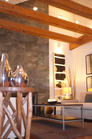 A modern and chic living room, Welcome to our living room. Come on in, have a sit and let me tell you a little bit about this room. Our space was designed to work well with our style as well as our lifestyle. We like it simple, no clutter. We like it modern looking, fresh and chic. We chose muted colors that work well together. The wooden beams and fireplace are the focal point of the room. It is the first thing people talk about when they come in the house. My brother-in-law did the two beautiful paintings that flank the fireplace. He actually painted them after the room was done. And we think he did a beautiful job. When we hung the paintings on the wall, it was like putting the perfect, well matched icing, on the cake. We are very pleased with how everything turned out. What about you?  What do you think? Feel free to e-mail me at patchi@trendypeas.com for all the sources., View from when you come in the room , Living Rooms Design