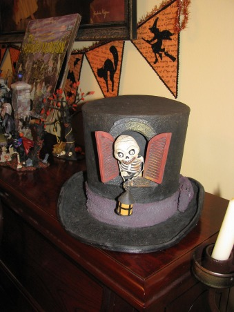 "Halloween by Michelle, Halloween, for me, is about magic and whimsy.  I like decorating with a ""Yester-year"" style, using little witches and black cats,  paper mache pumpkin heads and crate paper ruffles.  My haunt, inside and out, is ""little kid friendly"" and I won't put anything up that will scare them.     , Skeleton in a top hat, kids love this!   , Holidays Design"