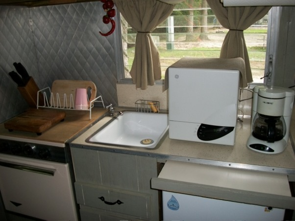 remodeled vintage camper, Trashed camper remodeled on a budget, totally electric after removing old rusted propane gas lines...can be run off of small generator  , Other Spaces Design