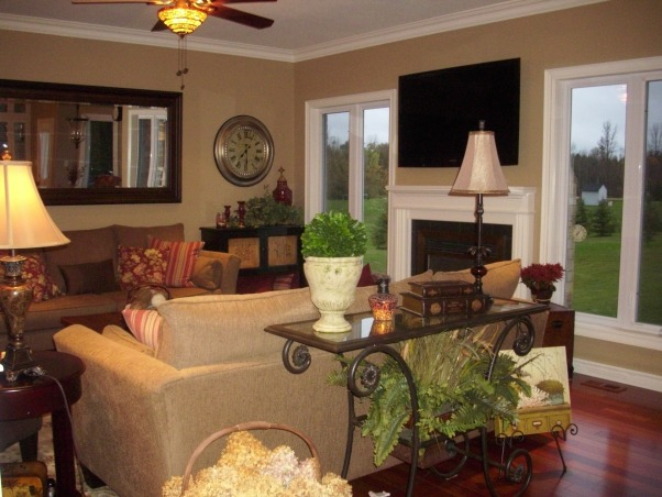 """Updated great room, The great room is one of the many renovation we have taken on since we purchased our home 2 ½ yrs ago. As a matter fact this was a smaller reno compared to the rest of the house, we in stalled 3"""" Brazilian cherry floors, pot lights, painted the fireplace mantel, and walls. We purchase new sofas and a new area rug. Please note I have no intentions of keeping the big screen TV above the fireplace it will be going to our basement when the basement is completed and replaced it with some art work. , Living Spaces"""