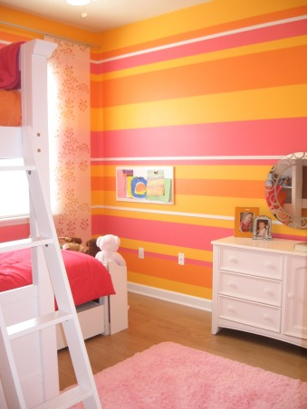 Striped bedroom for 2, This is the bedroom that my 3 & 5 year old girls share.  One likes pink, the other yellow, so we added some orange and went with it.  It is bright and cheerful which fits them well., We did two of the wall striped.  The rest are in the yellow color.  The white bands are actually wood moulding strips to add a bit more interest and dimension to the walls. , Girls' Rooms Design